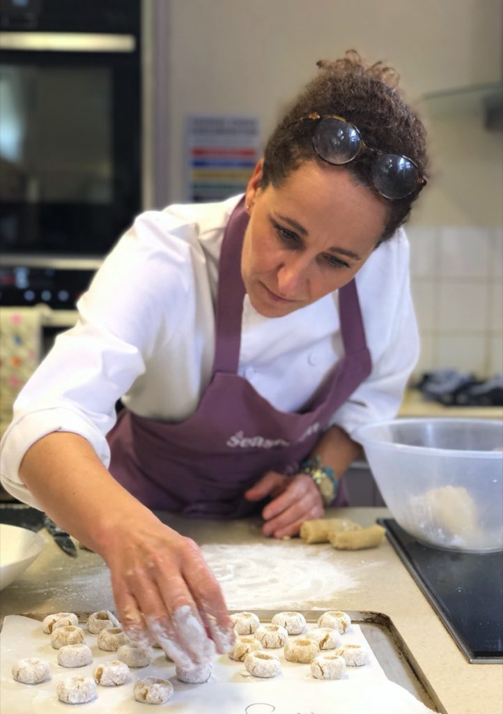 Sara Danesin making amaretti biscuits
